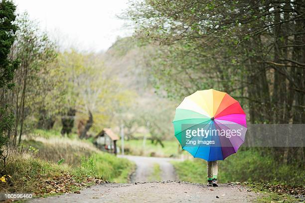 Girl with colourful umbrella