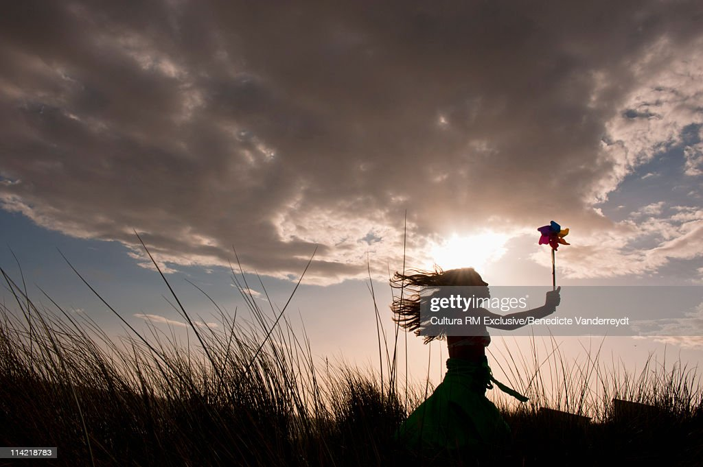 Girl with compass rose at sunset : Stock Photo