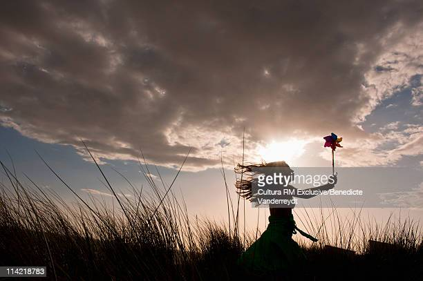 Girl with compass rose at sunset