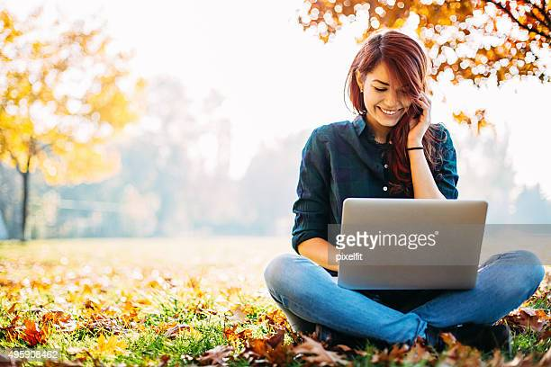 Girl with computer during fall