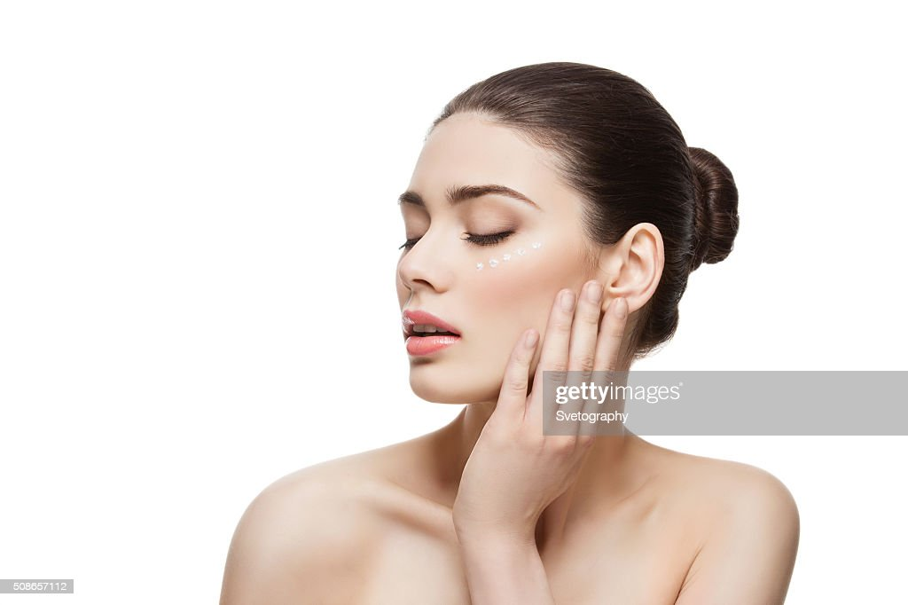 Girl with cream dots on face : Stock Photo