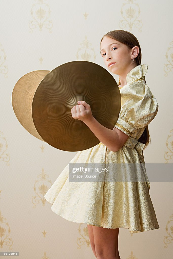 Girl with cymbals : Stock Photo