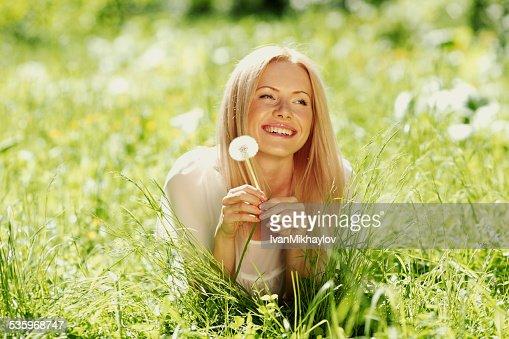 girl with dandelion : Stock Photo