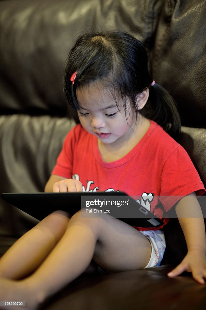 Girl with digital tablet : Stock Photo