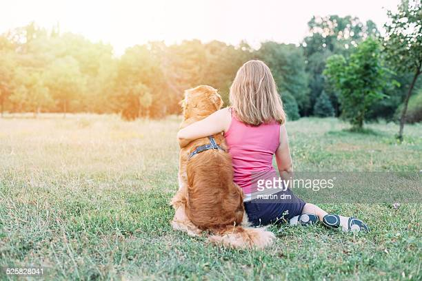Girl with dog outside