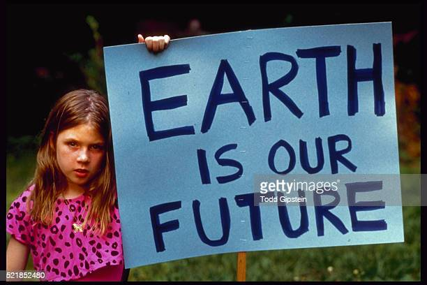Girl With Earth is Our Future Sign