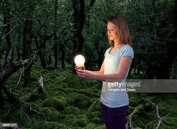 girl with energy saving light bulb