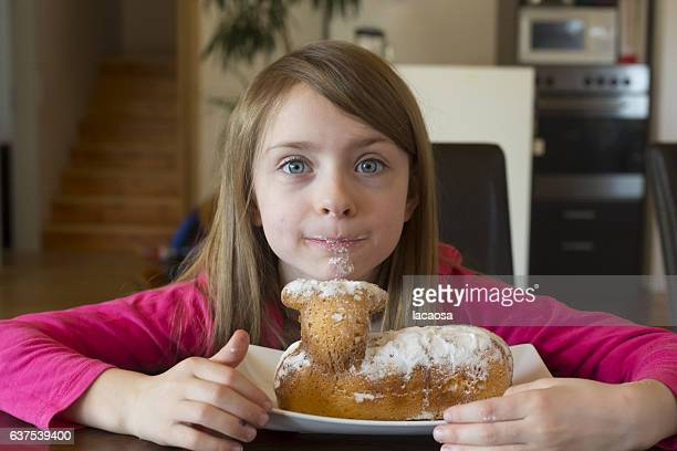 girl with eqaster lamp shaped cake