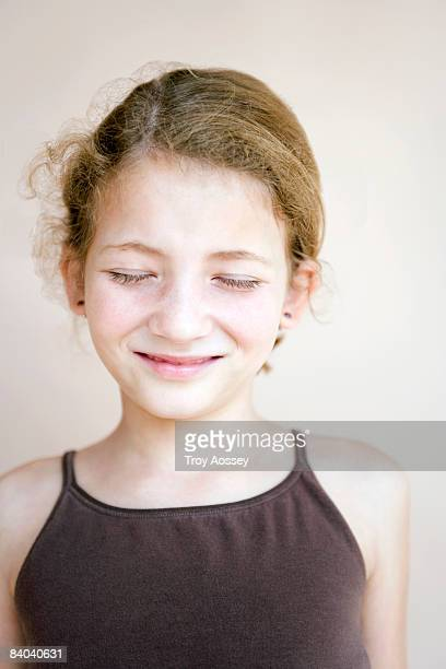 girl with eyes closed smiling