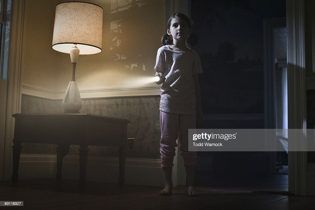 girl with flashlight searching : Stock Photo