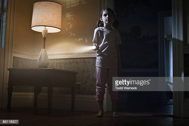 girl with flashlight searching