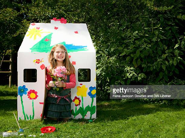 A girl with flowers and a wendy house