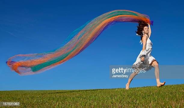 Girl With Flowing Fabric Running on the Hilltop Horizon