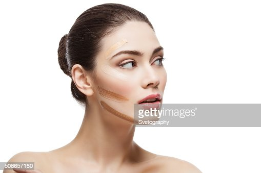 Girl with foundation cream on face : Stock Photo