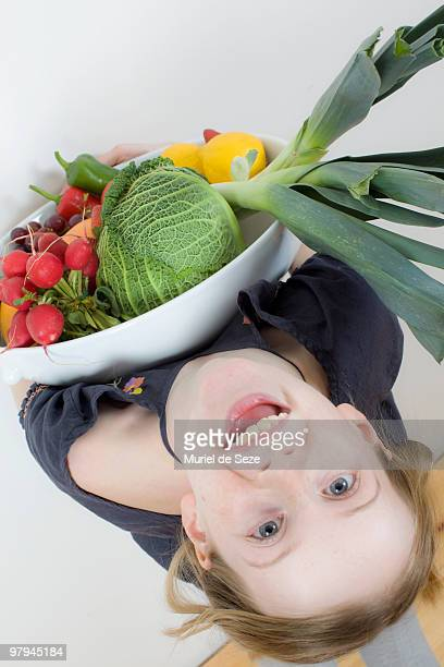 Girl with fruit dish, laughing