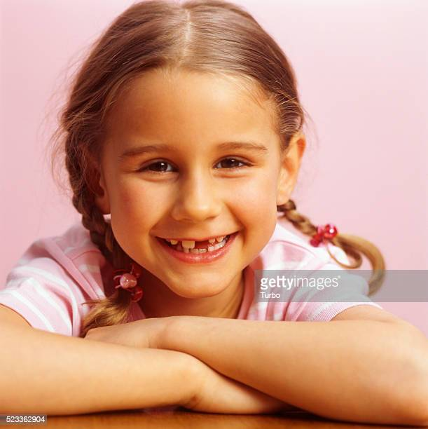 Girl with Gap Between Her Teeth Smiling