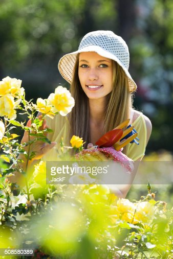 Girl with garden tools : Stock Photo