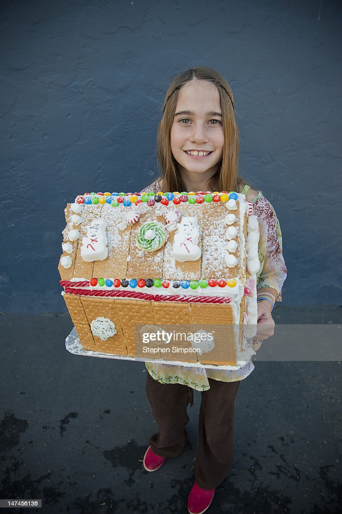 girl with graham cracker/candy house she made : Stock Photo