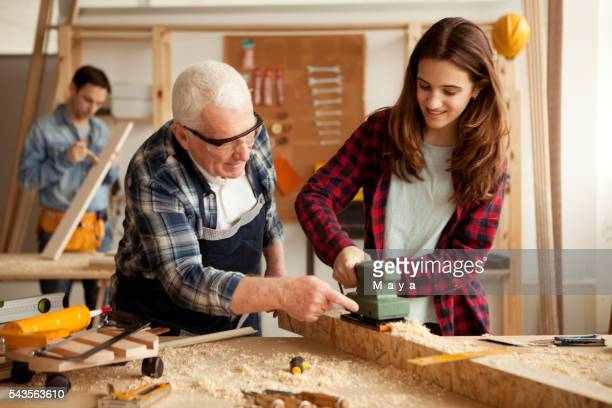 Girl with grandpa and father at woodshop