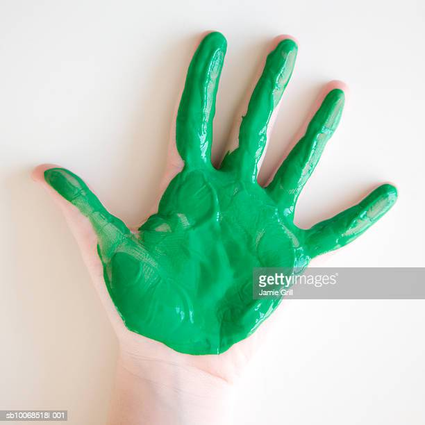 Girl with green paint on hand