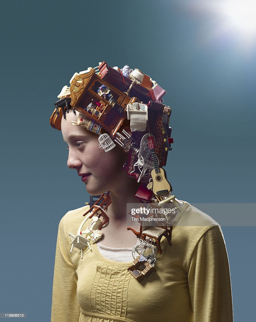 Girl with hair made from dolls furniture