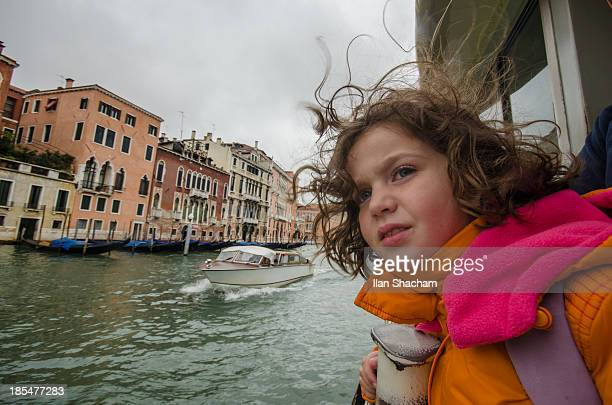 Girl with hair waving sailing in venice
