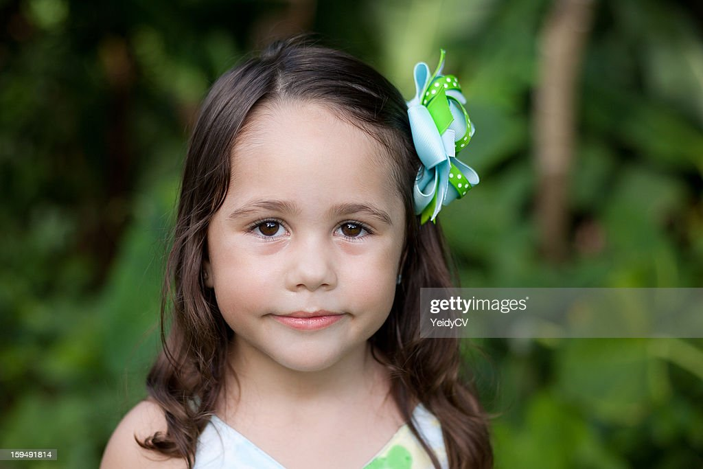 Girl with hairbow : Stock Photo