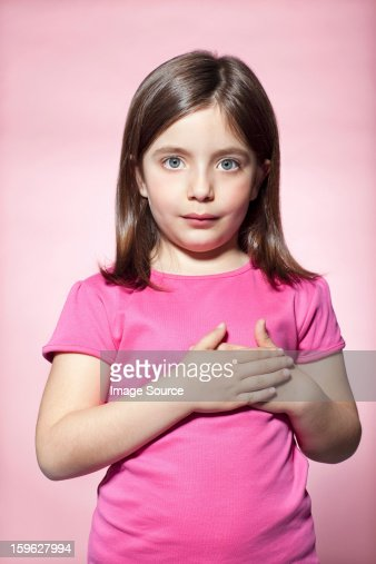 Girl with hands on heart