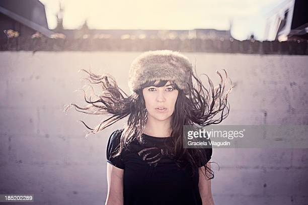 Girl with hat and flying hair