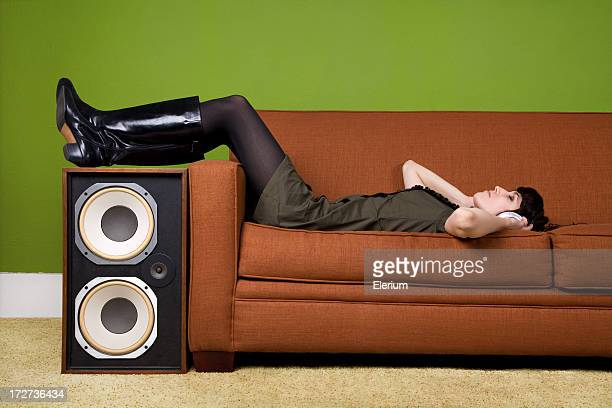Girl with Headphones on Retro Couch