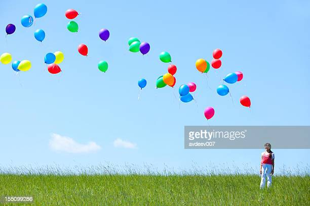 Girl with helium balloons