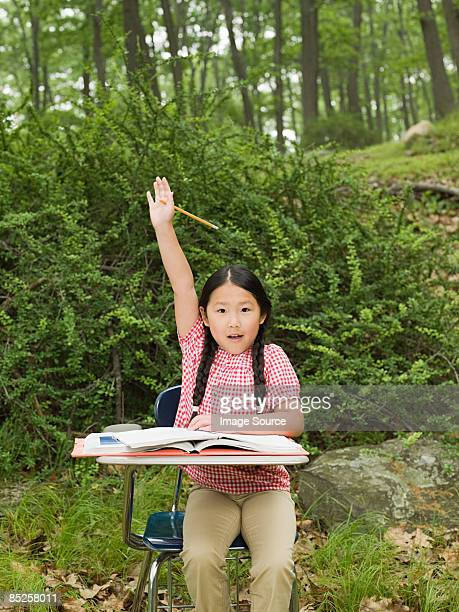 A girl with her arm raised