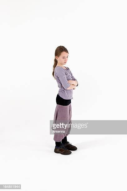 A girl with her arms crossed and looking away angrily