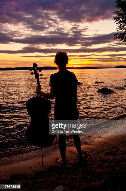 Girl with her Cello at Sunset