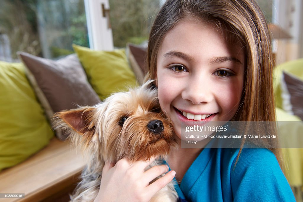 Girl with her dog, smiling : Stock Photo