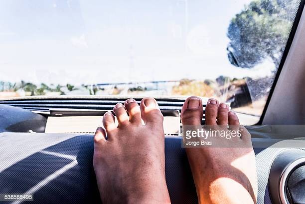 Girl with her feet on the dashboard.