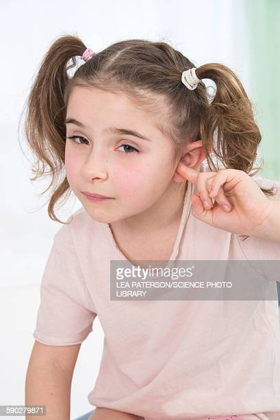 Girl with her finger in her ears