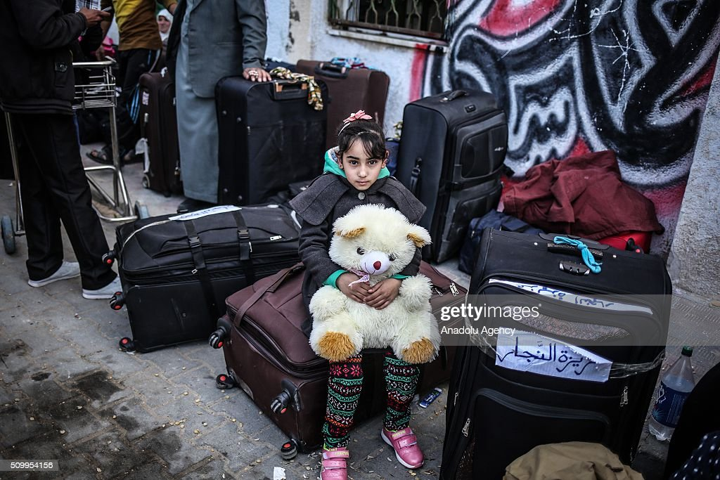 A girl with her teddy bear is seen as Palestinians wait to cross into Egypt at Rafah border crossing on the border between Egypt and the Gaza Strip in Rafah, Gaza on February 13, 2016.
