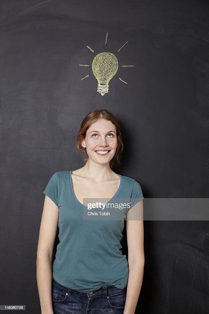 Girl with idea light bulb : Stock Photo