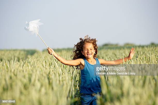 Girl with in a pinwheel in a field