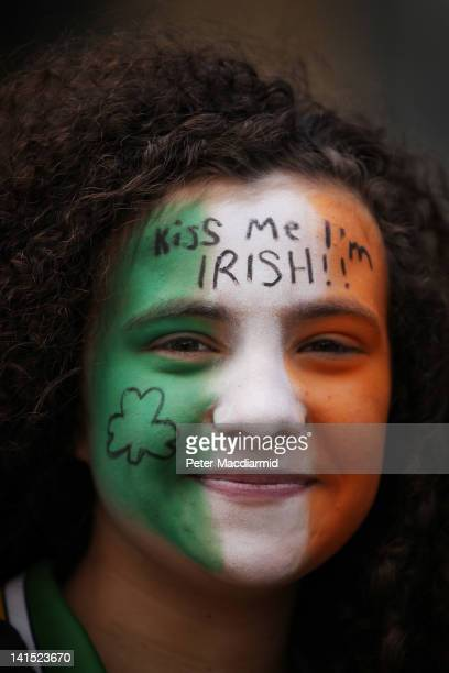 A girl with Irish Tricolour face paint watches a St Patrick's day parade on March 18 2012 in London England Thousands of people lined the streets for...
