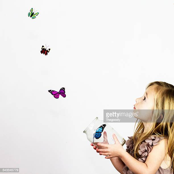 Girl with jar of butterflies