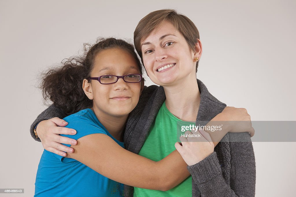 Girl with learning disability hugging her mentor