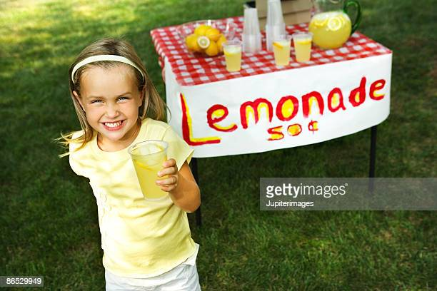 Girl with lemonade stand