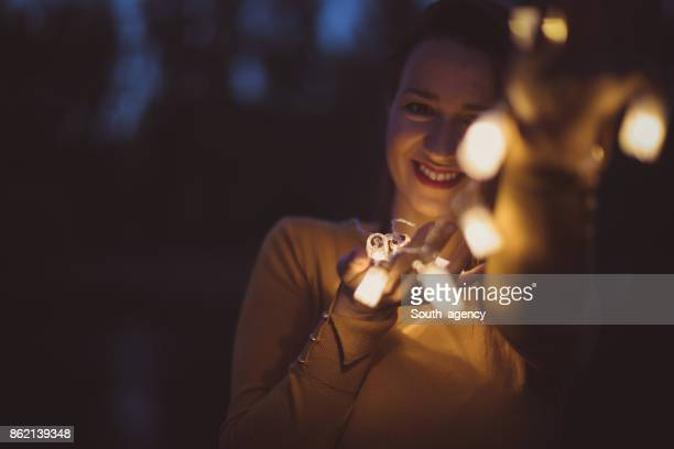 Girl with light bulbs