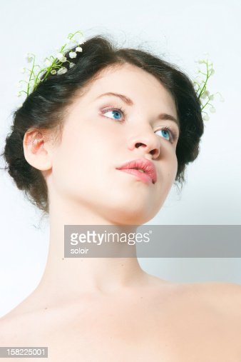 girl with lilies of the valley in hair : Stock Photo