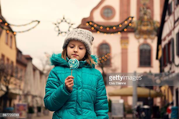 Girl with lollipop in German town