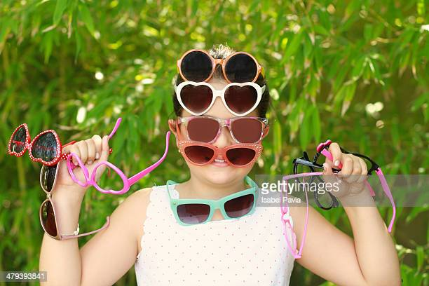 Girl with lots of sunglasses