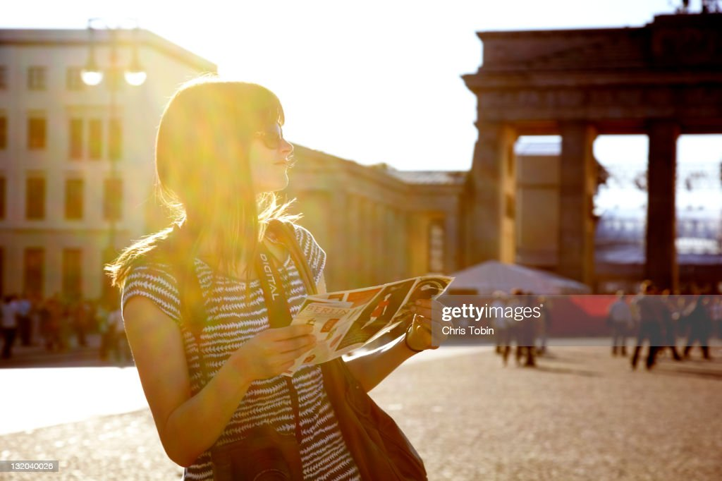 Girl with map at Brandenburger Tor : Stock Photo