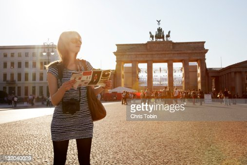Girl with map at Brandenburger Tor